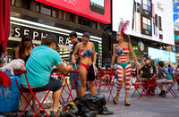 Desnudas getting ready for work. Times Square.