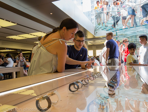 Apple flagship store, 5th Ave.  NYC. Looking at the Apple watch.